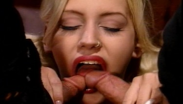 She Inhales One Stiffy While The Other One Ravages Her