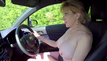 Mature Blondie Dame Sonia Plays With Her Boobs While Driving